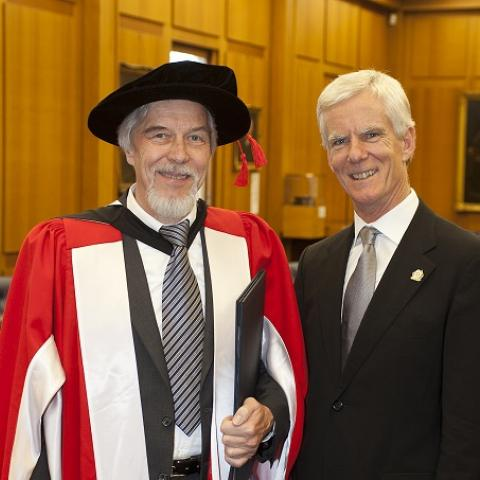 Prof Heuer with CoEPP Centre Director Geoff Taylor